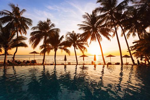 istock beautiful sunset on the beach, holidays background 875661236
