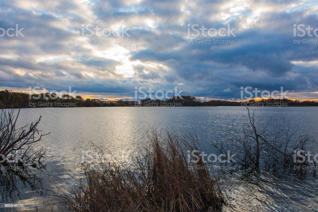 beautiful sunset on the lake stock photo