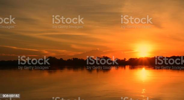 Photo of Beautiful sunset on the river bank.