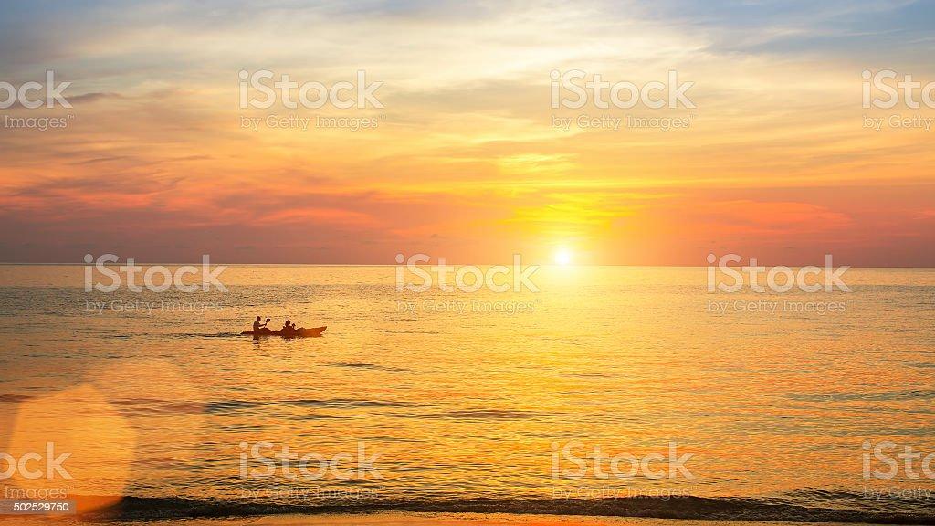 Beautiful sunset on the sea coast in calm weather. stock photo