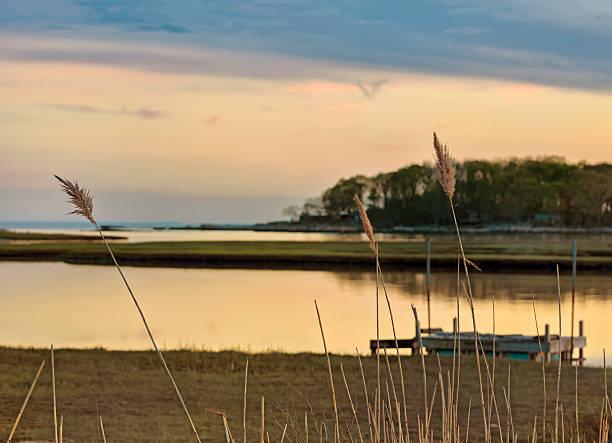 Beautiful sunset over a New England tidal salt marsh stock photo