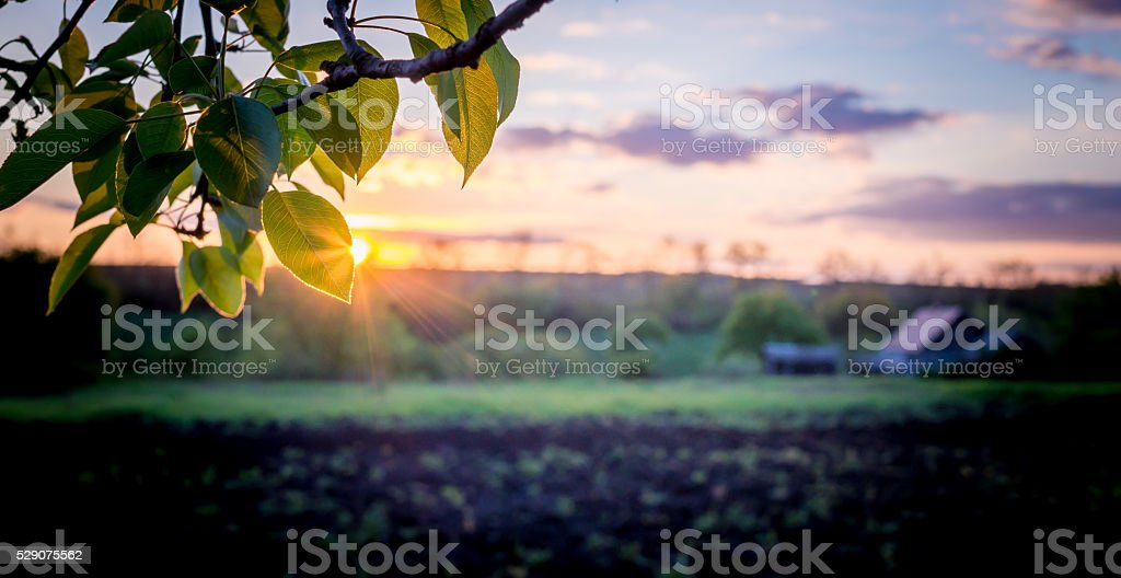 Beautiful sunset over a peaceful European village landscape stock photo