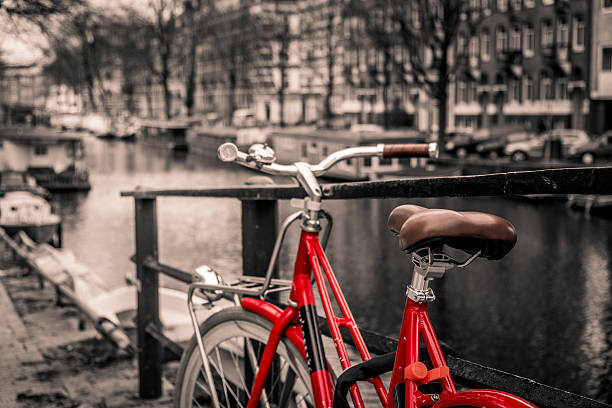 Beautiful sunset over Amsterdam, with bicycle selective colors – Foto