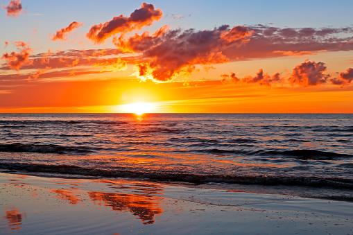Beautiful Sunset Over Baltic Sea with cloud and beams, Jurmala