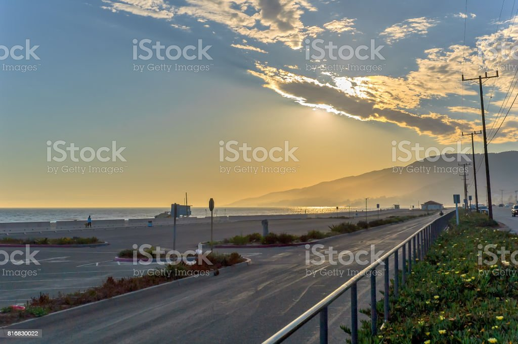 Beautiful sunset over California beach, seen from Pacific Coast Highway stock photo