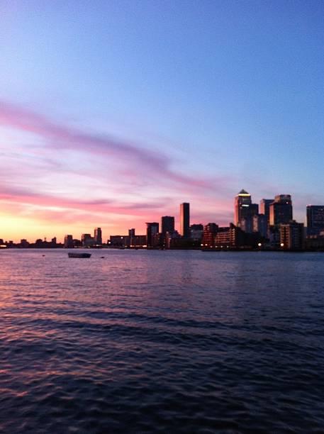 A beautiful sunset over Canary Wharf. stock photo