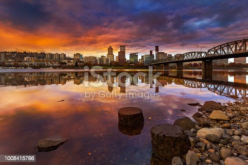 A beautiful sunset over downtown Portland Oregon waterfront along Willamette River from Eastbank Esplanade
