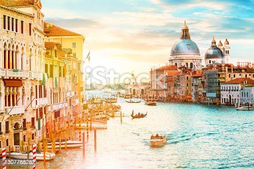 istock Beautiful sunset over Grand Canal and Basilica Santa Maria della Salute in Venice, Italy. 1307788282