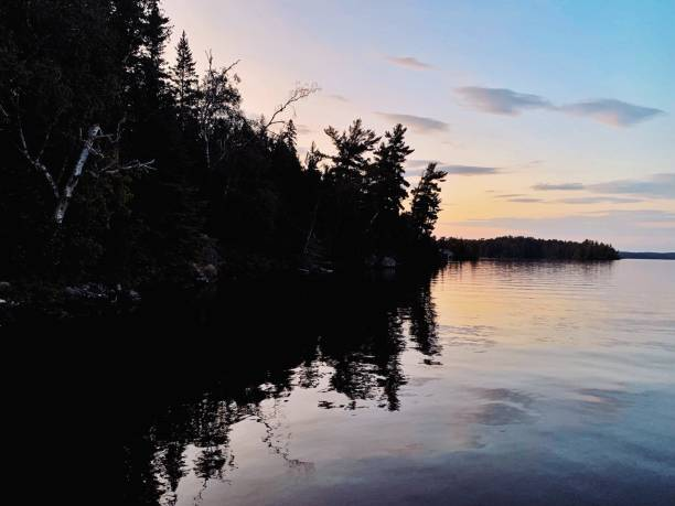 Beautiful sunset over lake in northwoods stock photo