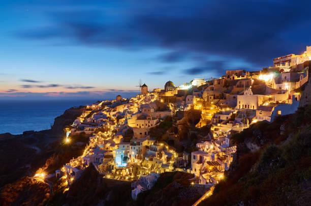 Beautiful Sunset over Oia in Santorini island - Greece stock photo