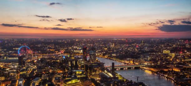 Beautiful sunset over old town of city London, England Beautiful sunset over old town of city London with London Eye wheel and bridges over river Thames, England, Europe. southeast england stock pictures, royalty-free photos & images
