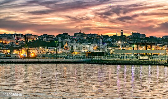 istock Beautiful sunset over the coastal town of Tangier in Morocco. 1212035646