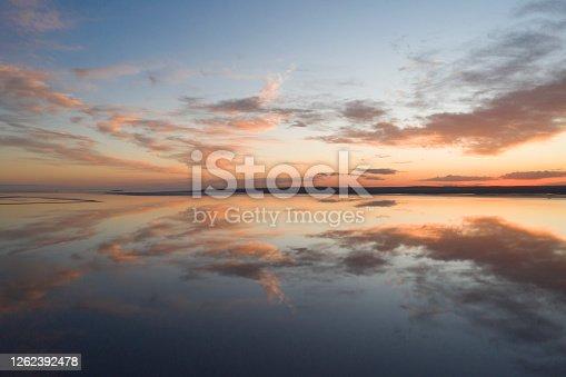 istock Beautiful sunset over the lake 1262392478