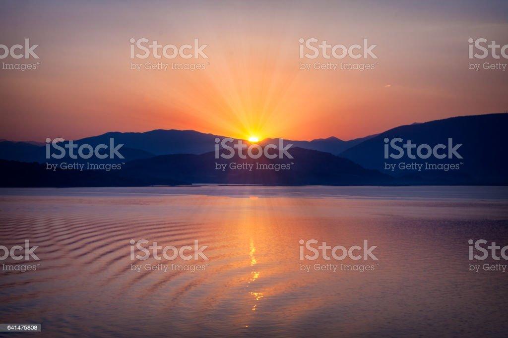 Beautiful sunset over the ocean. Sunrise in the sea stock photo
