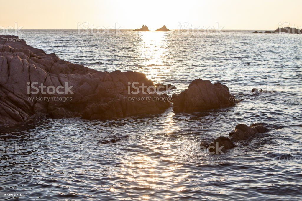 Beautiful sunset over the rocky seashore royalty-free stock photo