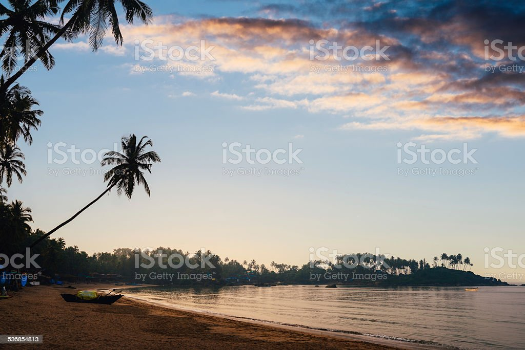 Beautiful sunset over tropical beach stock photo