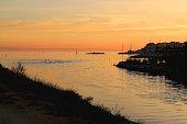 Beautiful sunset over the sea in Stobrec, small town near Split, Croatia.