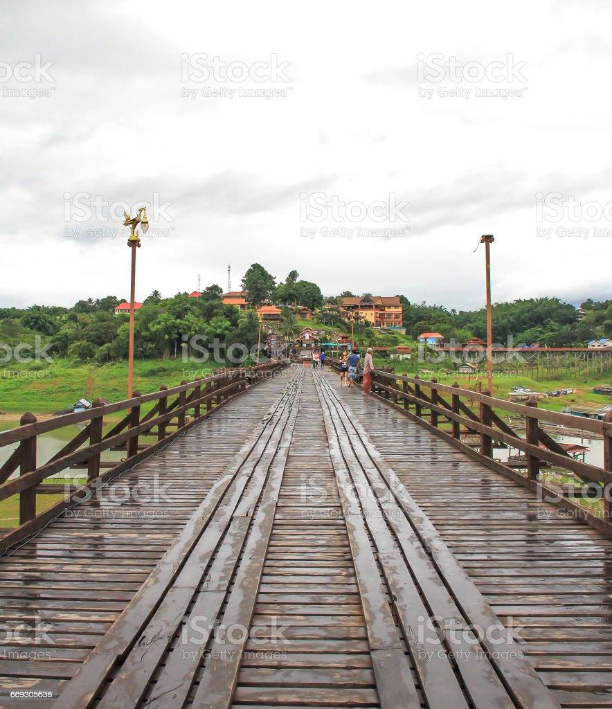 Beautiful sunset scene at old an long wooden bridge stock photo