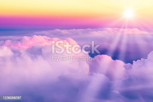 1045890176 istock photo Beautiful sunset sky above clouds. View from airplane window 1226058297
