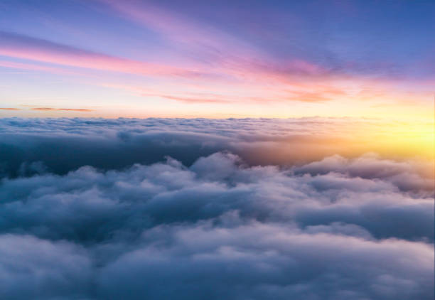 Beautiful sunset sky above clouds with nice dramatic light.