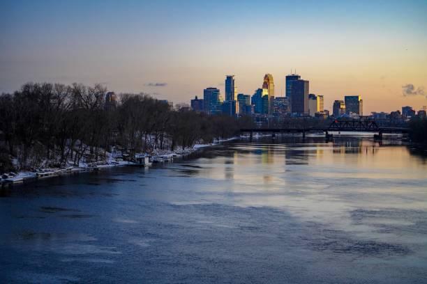 Beautiful Sunset Skyline of Minneapolis from the Lowry Avenue Bridge stock photo