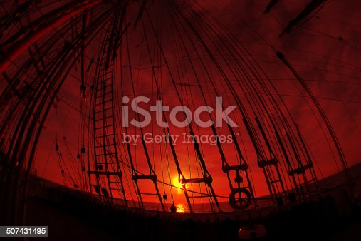 beautiful sunset through the rigging of an old sailing ship