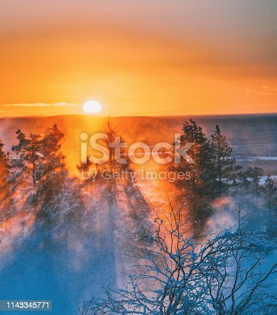 istock Beautiful sunset view on foggy and snowy forest in Lapland, Finland 1143345771