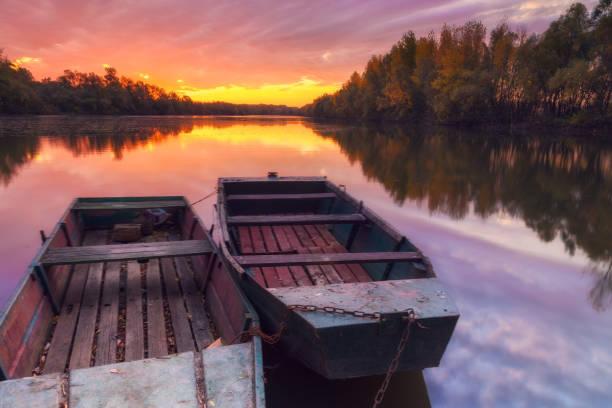 Beautiful sunset with fishing boats on Tisza river stock photo