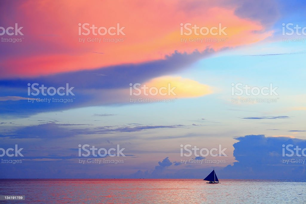 beautiful sunset with sea and sailboat royalty-free stock photo