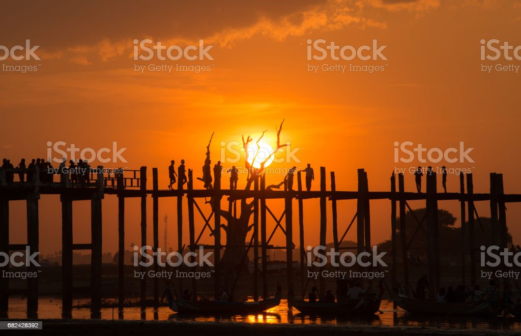 Beautiful sunset with the silhouette of U Bein bridge, Mandalay region of Myanmar. royalty-free stock photo