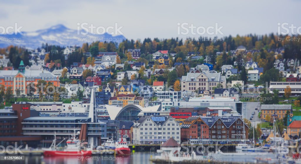 Beautiful super wide-angle panoramic aerial view of Tromso, Norway with harbor and skyline with scenery beyond the city, sunny summer day with blue sky stock photo