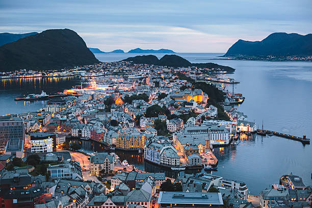 Beautiful super wide-angle summer aerial view of Alesund, Norway Beautiful super wide-angle summer aerial view of Alesund, Norway, with skyline and scenery beyond the city, seen from the observation deck of Aksla mountain oslo stock pictures, royalty-free photos & images