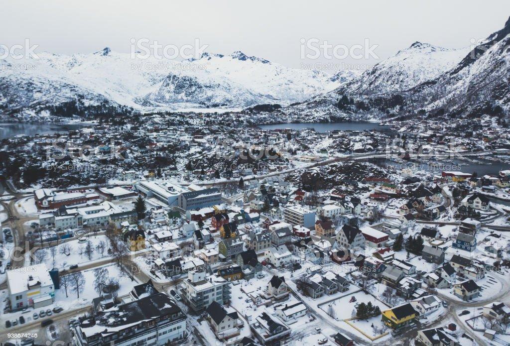 Beautiful super wide-angle winter snowy view of Svolvaer, Norway, Lofoten Islands, with skyline, mountains, Austvagoya island, Vagan municipality, Nordland, Northern Norway stock photo