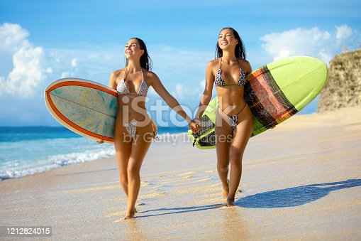 Beautiful surfer girls on the beach