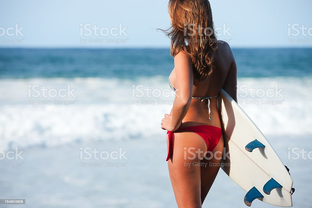 Beautiful surfer modeling with board in Hawaii. stock photo