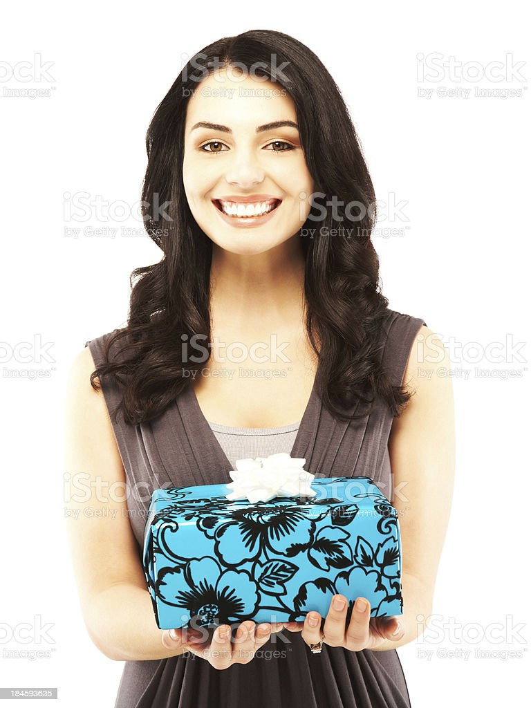 Beautiful surprised woman holding gift looking off royalty-free stock photo