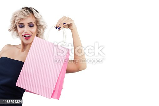 Beautiful surprised woman with shopping bags portrait on white background