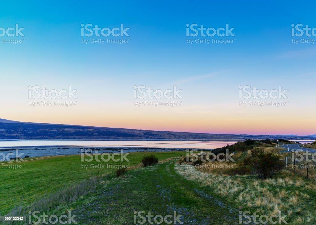 Beautiful sweet colour Pukaki lake in twilight at dusk , Mackenzie District, Canterbury , South Island of New Zealand stock photo
