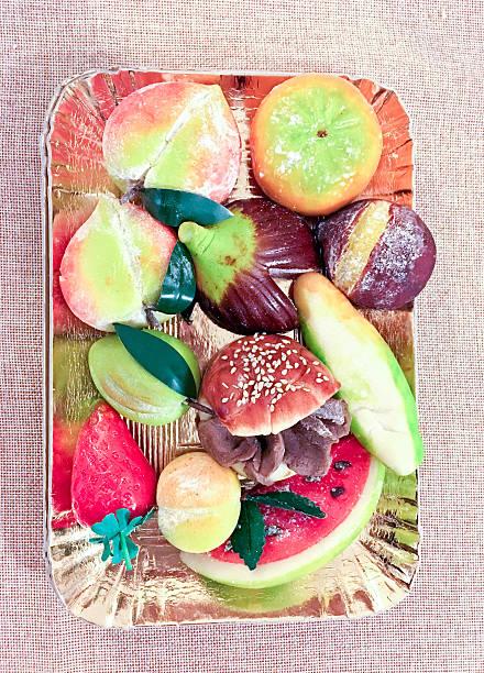 beautiful sweets made of marzipan of various shapes - apfel marzipan kuchen stock-fotos und bilder