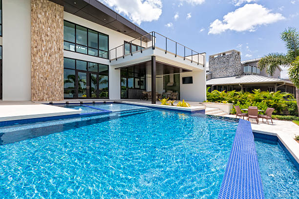 Beautiful Swimming Pool and Modern Home stock photo