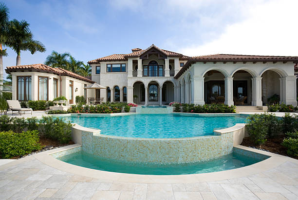 beautiful swimming pool at an estate home - stately home stock photos and pictures