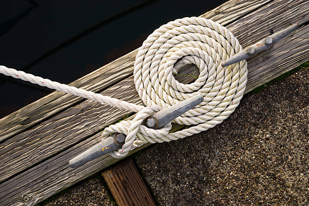 Beautiful Swirled Curled Rope Boat Bow Line Nautical Tie Down A detail oriented loving boat own makes his rig impeccable all the way around mooring stock pictures, royalty-free photos & images