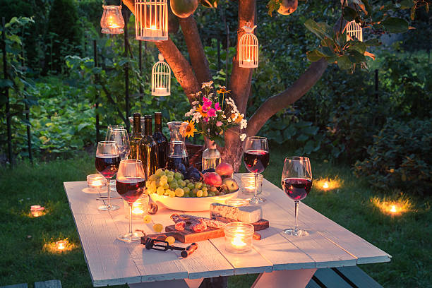 beautiful table full of cheese and meats in garden - formal garden stock photos and pictures