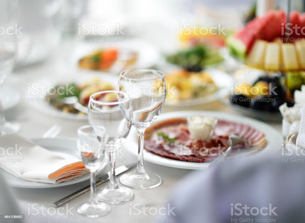 Beautiful table set with three glasses for a party, wedding reception or festive event stock photo