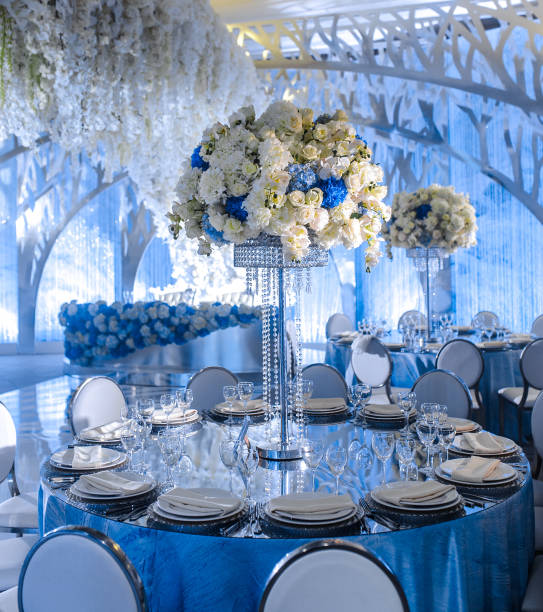 beautiful table setting for an wedding reception or an event - blue table setting stock photos and pictures