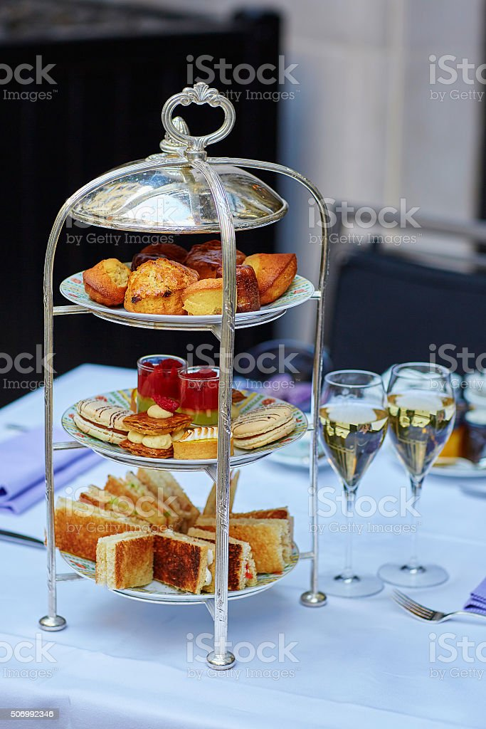 Beautiful table setting for high tea ceremony stock photo