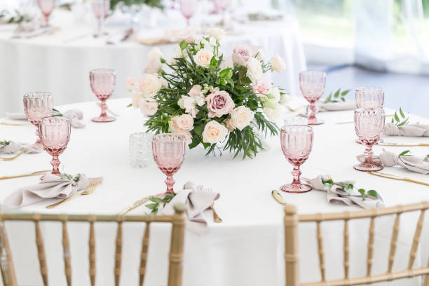 beautiful table setting with crockery and flowers for a party, wedding reception or other festive event. glassware and cutlery for catered event dinner. - sport set competition round stock photos and pictures