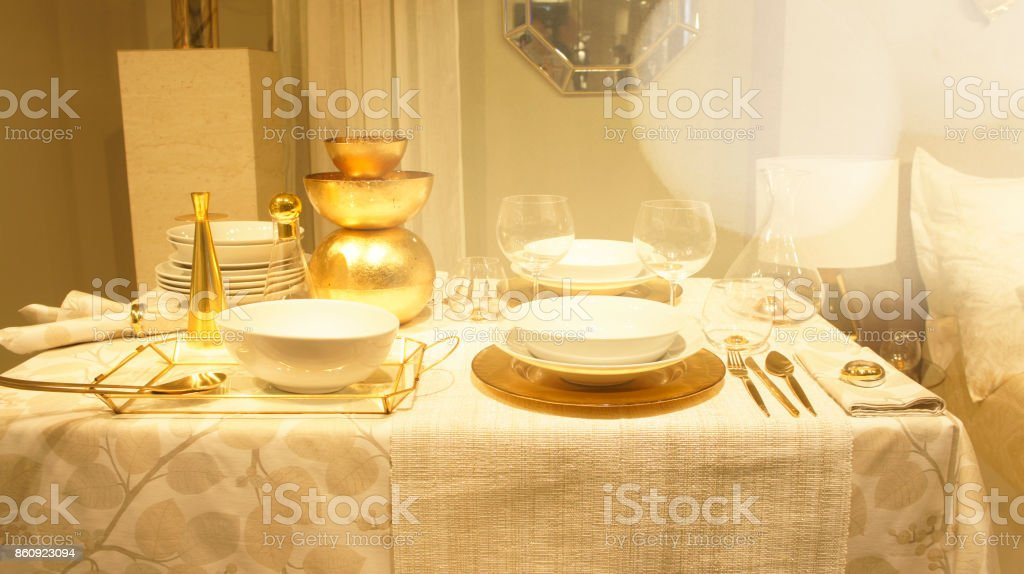 Beautiful table setting with crockery for a party, wedding reception or other festive event. Glassware and cutlery for catered event dinner. stock photo