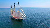 Beautiful tall ship sailing calm waters in good weather