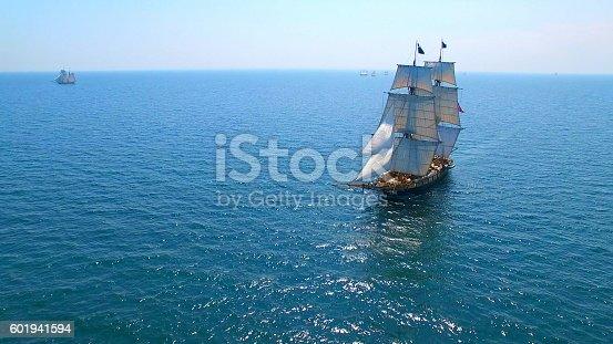Beautiful tall ship sailing deep blue waters toward adventure.